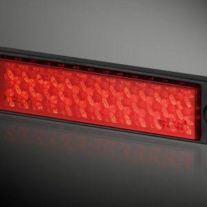 Odblask prostokątny UP-20L RC czerwony  21 x 90mm, 2 otwory, ramka czarna