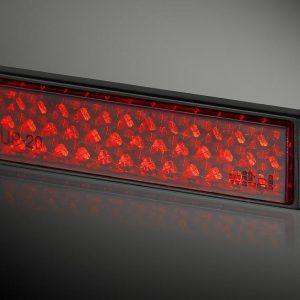 Odblask prostokątny UP-20T RC czerwony  21 x 72mm, taśma, ramka czarna
